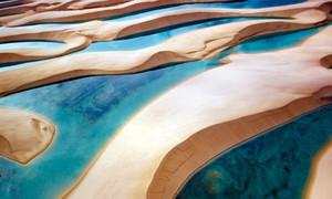 Nơi tiểu sa mạc 'lột xác' thành bãi tắm khổng lồ sau mưa