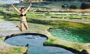 Hồ bơi hình số 8 tự nhiên trên vách đá