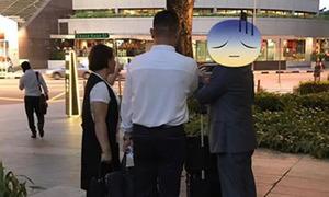Hai người Trung Quốc bị vạch trần mánh lừa đảo ở Singapore