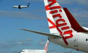 Hành khách dọa giết người buộc máy bay hạ cánh khẩn