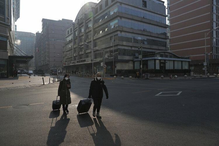 Đường phố Bắc Kinh vắng người vào 25/1. Ảnh:Wu Hong/EPA.