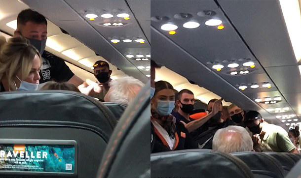 Những hành khách cùng phi hành đoàn cảnh cáo người đàn ông gây rối (tóc trắng, hói đầu). Ảnh: canarianweekly tenerife