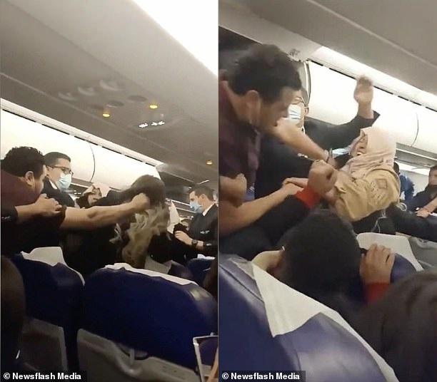 Nữ hành khách bị người đàn ông túm tóc khi đang quay lưng bỏ đi. Ảnh: Newsflas