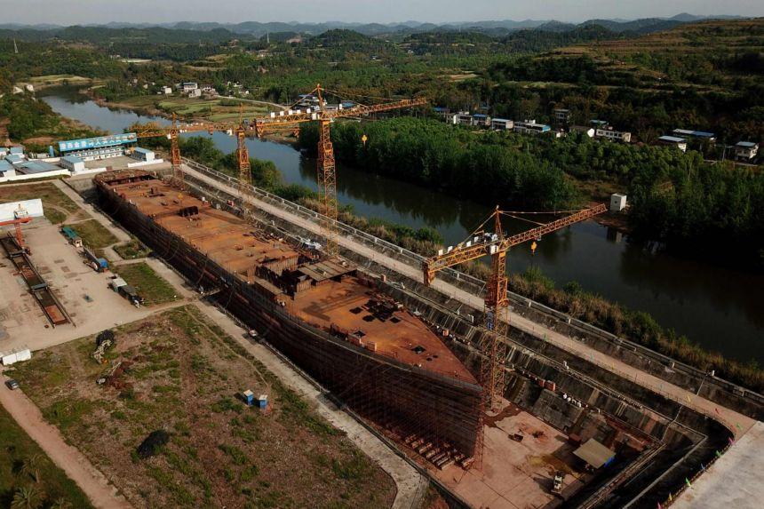 Quá trình xây dựng con tàu cho đến ngày 27/4/2021. Ảnh: AFP