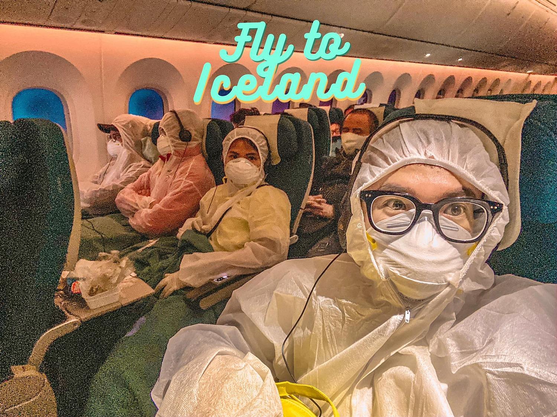 Nhóm Đạt mặc đồ bảo hộ trên chuyến bay tới Iceland. Ảnh: NVCC